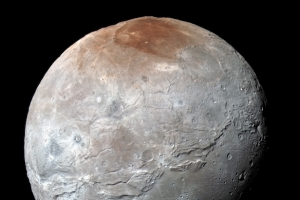New Horizons has found Pluto's largest moon Charon to be a world covered with mountains, canyons, landslides. Image Credit: NASA/JHUAPL