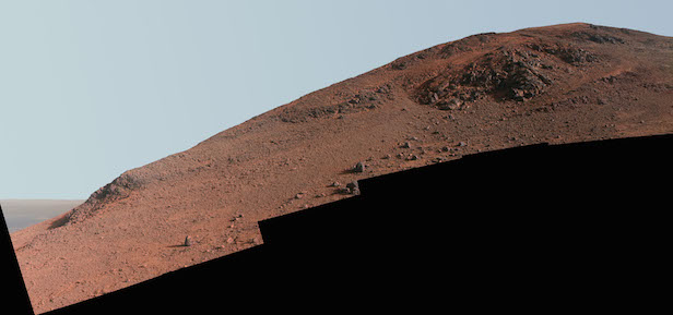 "This scene from NASA's Mars Exploration Rover Opportunity looks upward at ""Knudsen Ridge"" on the southern edge of ""Marathon Valley"" from inside the valley. Image Credit: NASA"