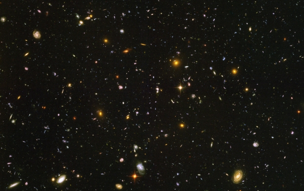 The Hubble Ultra Deep Field shows the universe to be populated by a huge number of moving stars and galaxies. Image credit: NASA