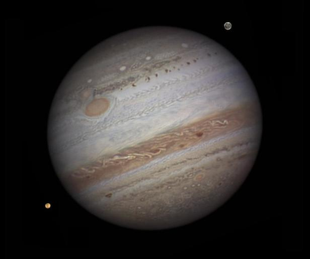 "This image was acquired by amateur astronomer Damian Peach on September 12, 2010, when Jupiter was close to opposition. South is up and the ""Great Red Spot"" is visible. Two of Jupiter's moons, Io and Ganymede, can also be seen in this image."